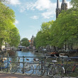 Bikes on the bridge in Amsterdam the Netherlands — Stock Photo