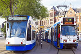 Trams waiting in front of the central station in Amsterdam the N — Foto Stock