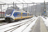 Train driving in the snow in Amsterdam the Netherlands — Stock Photo