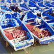 Blue fishing boats on an ocean coast in Essaouira, Morocco — Stock Photo