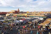 Djemaa el Fna market in Marrakesh, Morocco, with Koutubia Mosque — Stock Photo