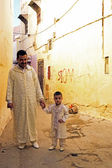 FES, MAROCCO - October 15 2013 : Father and son are dressed up on Eid al-Adha. — Stock Photo