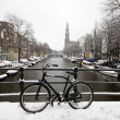 Amsterdam covered with snow with the Westerkerk in winter in the — Stockfoto