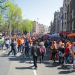 AMSTERDAM - APRIL 30: Big crowds in orange from people partying — Stock Photo