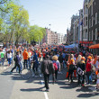 Stock Photo: AMSTERDAM - APRIL 30: Big crowds in orange from people partying