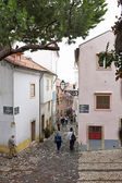 Old medieval street in Lisbon Portugal — Stock Photo