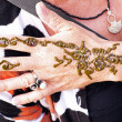 Hand painting with henna on the market in Marrakech Morocco — Stock Photo