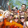 AMSTERDAM - APRIL 30: Group of friends in orange partying at the — Stock Photo