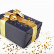 Christmas present with golden ribbon — Stock Photo