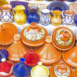 Colorful Tajines for sale in a market stall — Stock Photo