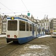 Stock Photo: Tram driving in snowy Amsterdam in the Netherlands