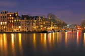 City scenic from Amsterdam in the Netherlands by night — Stock Photo