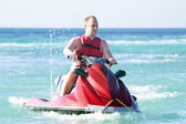 Young guy on a jet ski — Foto Stock