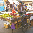 Merchant is selling fruits — Stock Photo