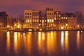 Amsterdam houses by night in the Netherlands — Stock Photo
