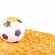 Soccer ball on orange confetti — Stock Photo #47363119