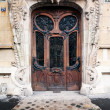 Elaborate old door in paris — Stock Photo