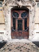 Elaborate old door in paris — Stock Photo