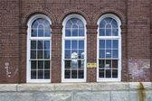 Glass window on bricked wall — Stock Photo