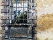Old wall with metallic bars — Stock Photo