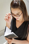 Business woman looking at her notebook planner — Stock Photo