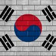 An image of the South Korea flag painted on a brick wall in an urban location — Stock Photo