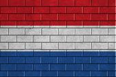 Nederländerna flaggan målad på en tegelvägg — Stockfoto