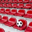 Stock Photo: Rows of red football stadium seats with numbers