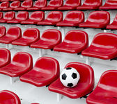 Rows of red football stadium seats with numbers — Stock Photo