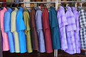 A colored shirts at the clothes shop — Zdjęcie stockowe