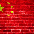 An image of the China flag painted on a brick wall in an urban location — Stock Photo