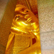 Reclining Buddha gold statue face. Wat Pho, Bangkok, Thailand — Stock Photo