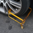 Clamped wheel of illegally parked car — Stok fotoğraf