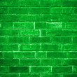 Green brick wall getting older from the bottom — Stock Photo
