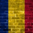 Romania flag painted on a brick wall — Stockfoto