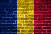 Romania flag painted on a brick wall — Stock Photo