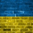 Ukraine flag painted on a brick wall — Stok fotoğraf