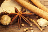 Herbs and Spices over wooden background — Stock Photo