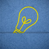 Light icon on blue paper texture  — Stock Photo