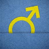 Mužské symboly na modrý papír textury — Stock fotografie