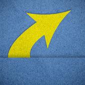 Arrow on blue paper texture — Stock Photo