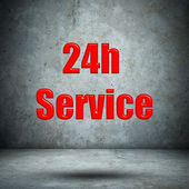 Service 24H Icon on concrete wall — ストック写真