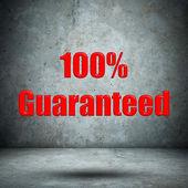Guaranteed on concrete wall — Stock Photo