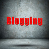 Blogging on concrete wall — Stock Photo