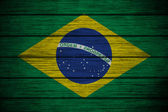 Brazilian flag on Background texture wood — Stock Photo