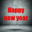Happy new year on concrete wall — Stock Photo #44927665