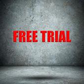 FREE TRIAL on concrete wall — Stockfoto