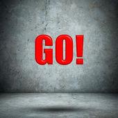 GO on concrete wall — Stock Photo