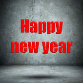 Happy new year on concrete wall — Stockfoto