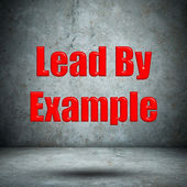 Lead By Example concrete wall — Stock Photo